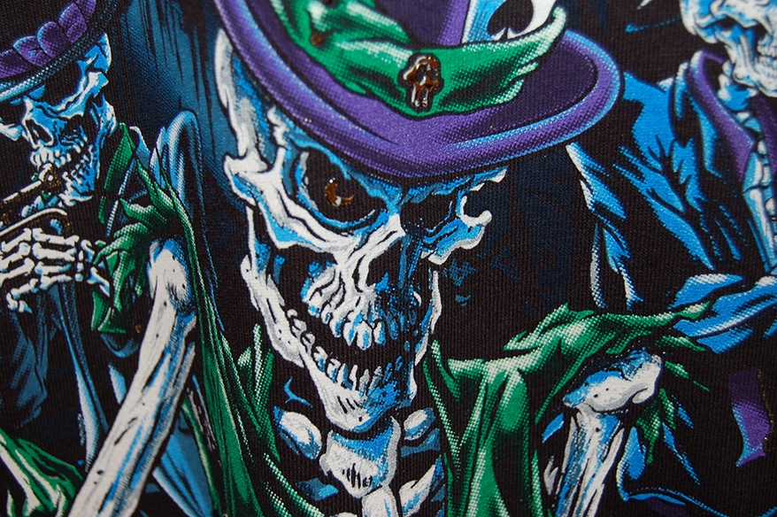 The skeleton's eye and hat detail feature an HD clear with a bronze ink sandwiched in the layers.
