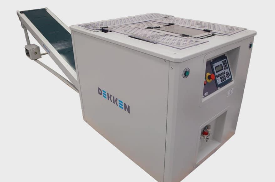 Dekken T-Mini garment folding/bagging machine folds 620 pieces/hr.