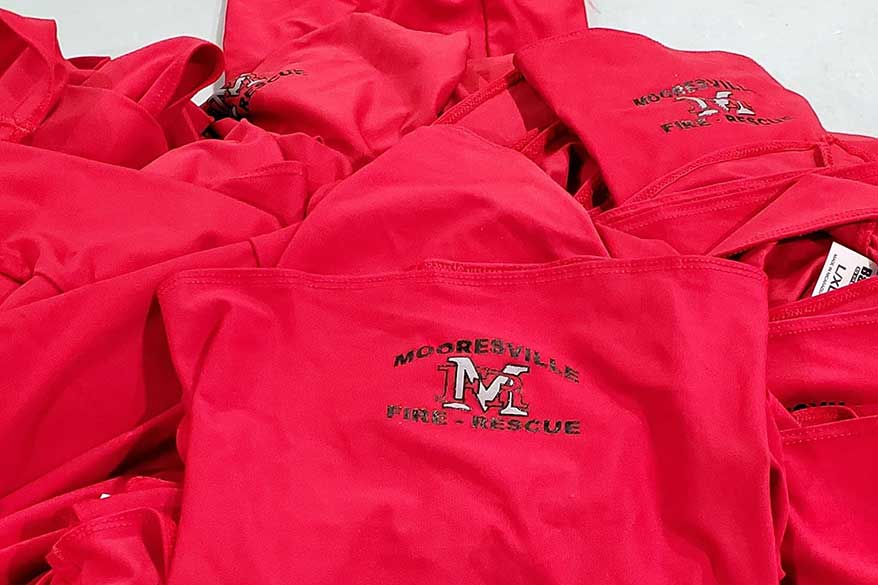 MI Screen Printing supplied Mooresville Fire Department with neck gaiters printed on the Vastex face mask pallet.