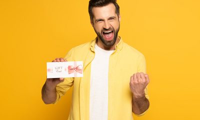 happy-man-hold-gift-card